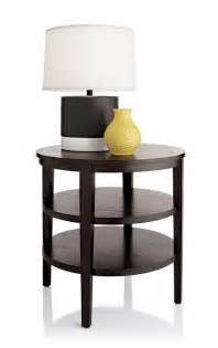 fancy side table for living room using two tier shelving and round wooden top on black wood