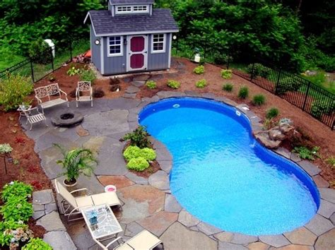 landscaping around a pool landscape ideas along a wooden fence inground pool