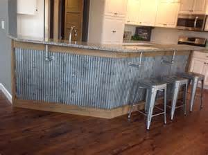 reclaimed barn tin roofing used as wanescoting under a bar useful finesse cabinet making wood project