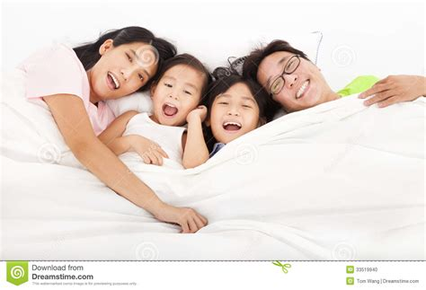 on the bed happy family on the bed stock photo image of concept