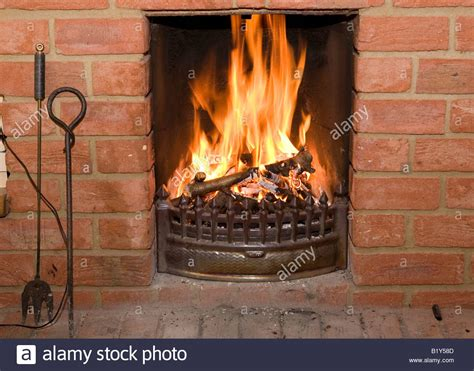 How To Open A Gas Fireplace by Open Burning In A Brick Fireplace Stock Photo