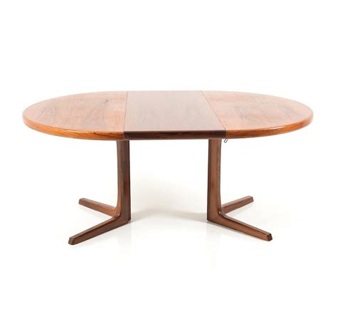 circular extendable rosewood dining table by faarup