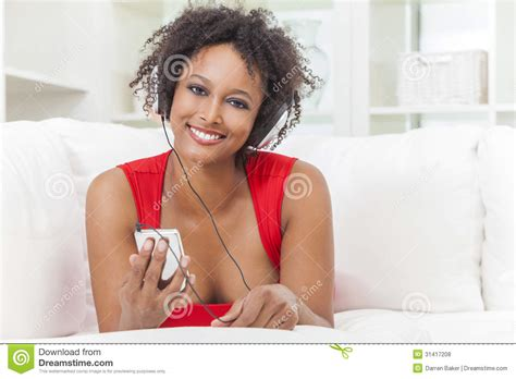 That Girl Mp | african american girl listening to mp3 player headphones