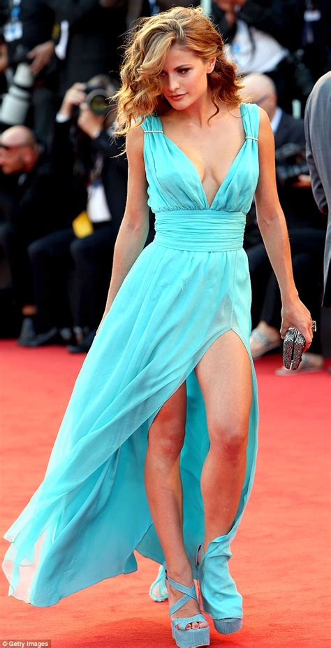 Electric Shock In Blue Green dazzles in plunging emerald green gown on the