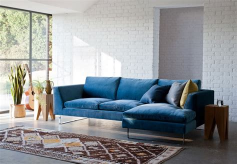 living room with blue sofa modern and stylish living room design with trendy blue