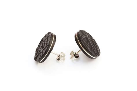 faced leather stud earrings black and silver