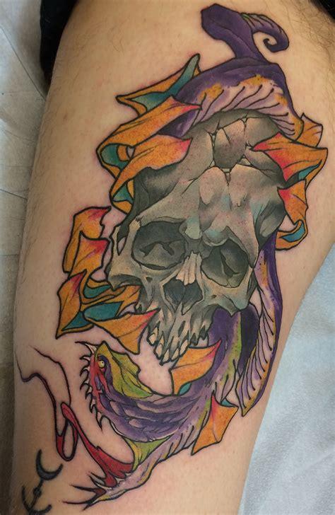 snake tattoo guy london ontario snake and damaged skull done by eugene lee riceeyes