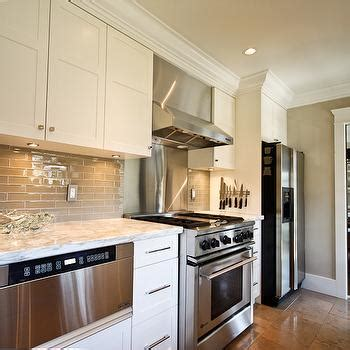 glossy cafe au lait upper cabinets in small space kitchen taupe kitchen cabinets contemporary kitchen veranda
