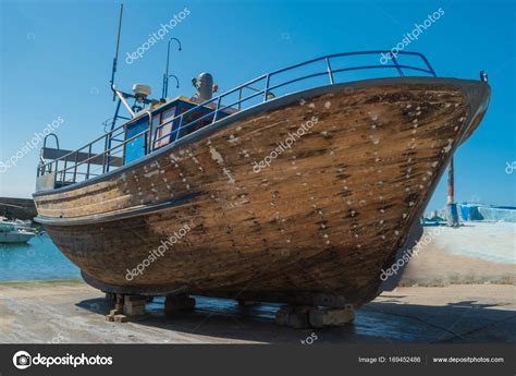dry dock boat repair repair of wooden boats in dry dock boats are raised and