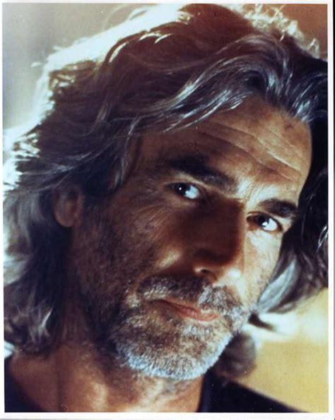 sam elliott long grey slickback hairstyle and handlebar mustache sam elliott only a few men can make long gray