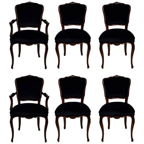 six dining room chairs with navy velvet and damask fabric