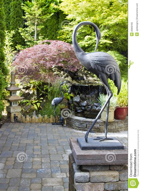 Statues And Sculptures Home Decorating Bronze Cranes In Japanese Inspired Garden Stock Image Image 25650165