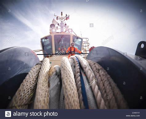 tugboat worker tugboat worker standing on bridge stock photo royalty
