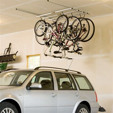 hang bike from ceiling saris cycleglide 4 bike ceiling storage system 56 jpg