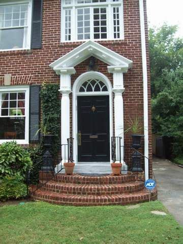 lovely front door  curved brick steps beautiful home