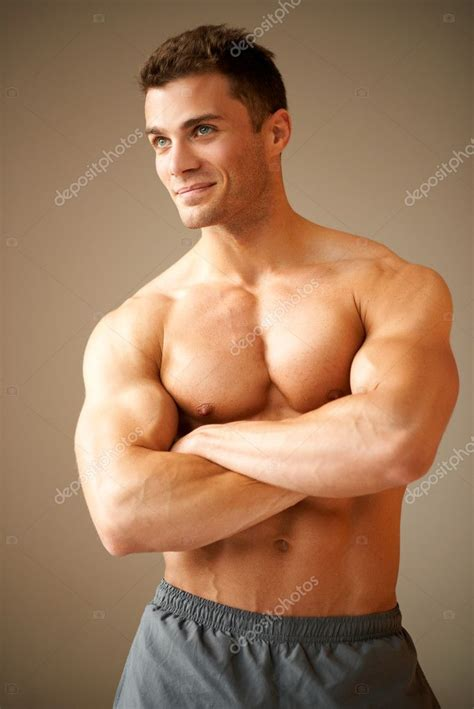 best stock photos of photo handsome man showing cell phone black smiling handsome man with muscular arms crossed stock