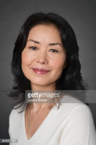portait of mature japanese woman white sweater stock photo