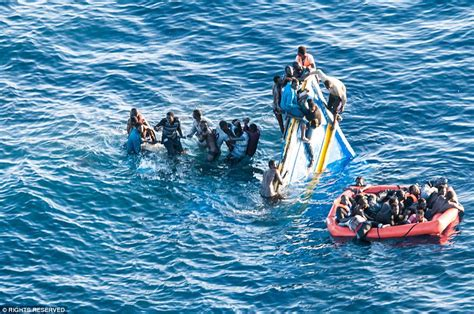 sinking rubber boat mediterranean migrants off libyan coast cling onto sinking