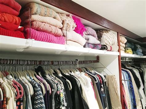 walk in closet with sweater shelf and acrylic dividers