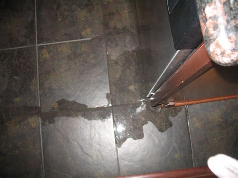 water leaking from under bathtub floor bathroom sink water leaking from ceiling under