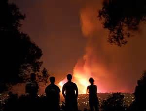Wildfire Spectators Cause Problems 210 homes destroyed in tea