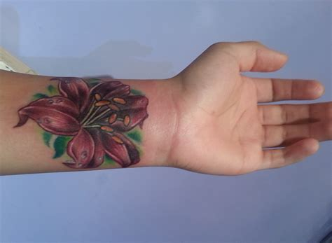 cover up wrist tattoo nyc s best cover up artist adal majestic nyc