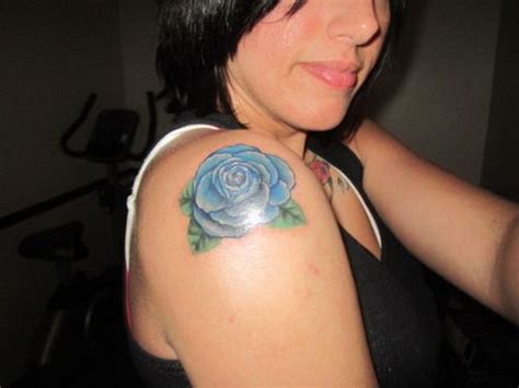 blue rose tattoo and piercing blue inspiration blue roses
