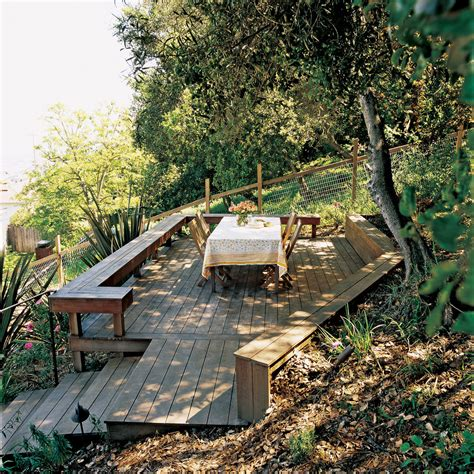 sloped backyard deck ideas taming a slope sunset
