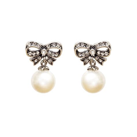 diamante bow and pearl earrings by bloom boutique