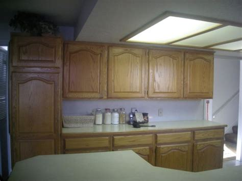 oak kitchen cabinets refinishing how to refinish kitchen cabinets without stripping photos