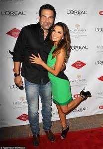 eva longoria steadies herself with pal s shoulder as she