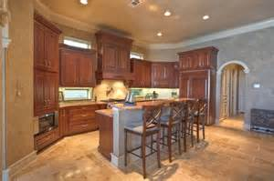 kitchen island with granite top and breakfast bar likes the idea of a bar style raised middle island even if