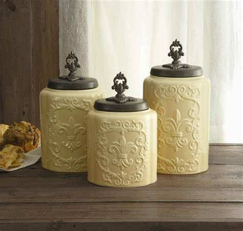 fleur de lis kitchen canisters set of three classy glass polystone fleur de lis decorative antique fleur de lis cream canister set ebay french