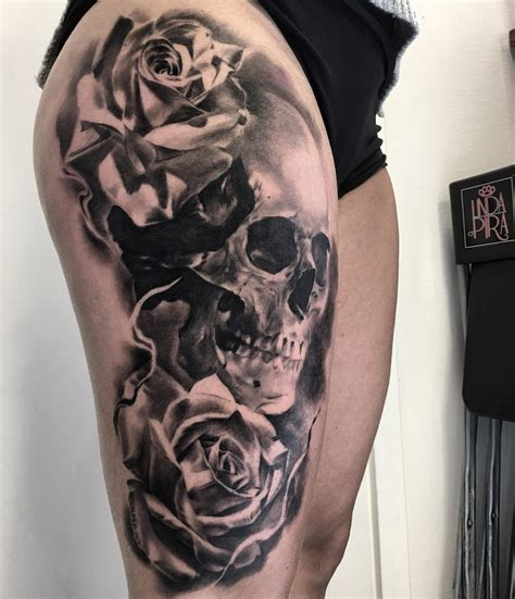 skull and rose tattoo on thigh made by stucklife on instagram skull