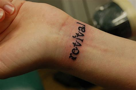 revival tattoo 25 spectacular one word tattoos creativefan