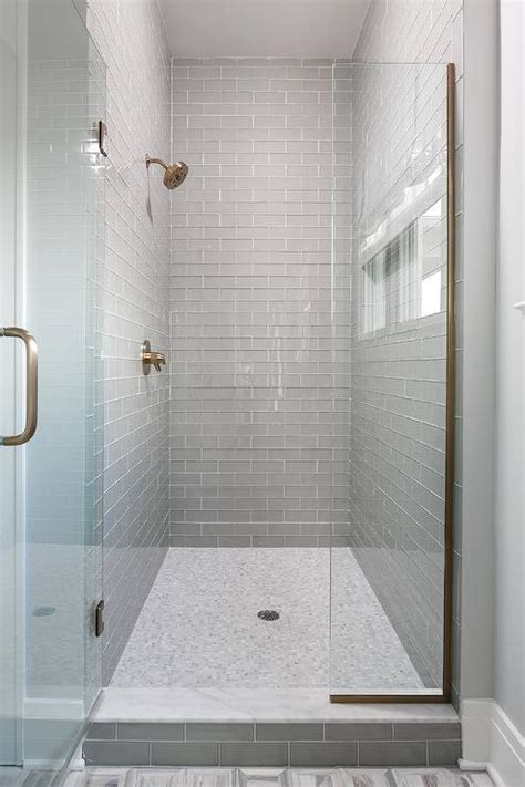 white subway tile walk in shower walk in shower with gray glass subway tiles and white marble grid floor modern bathroom