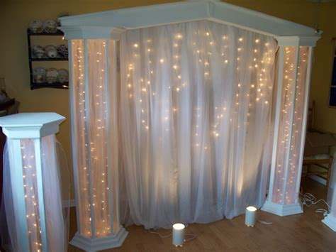 wedding backdrop ideas with columns lighted columns with panel tulle j a
