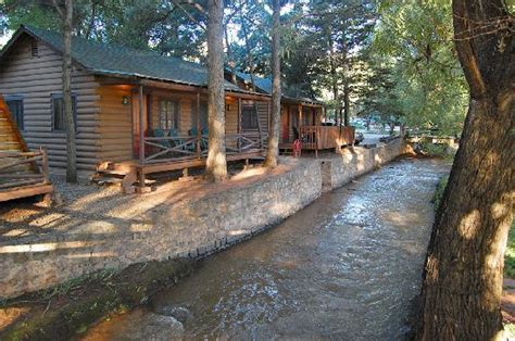 cabins nestle next to a free flowing creek flowing from