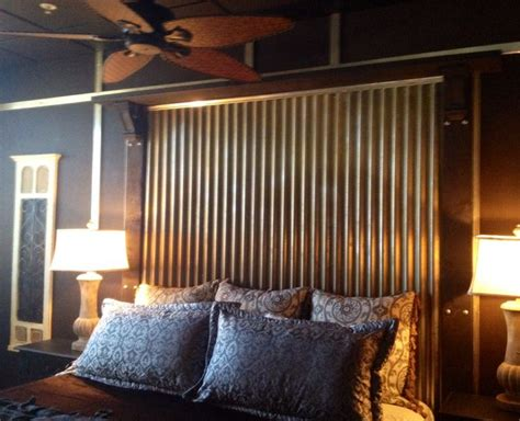 corrugated tin headboard did stained wood on the walls with trim pieces that were