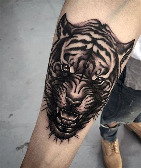 tiger forearm tattoo 100 tiger designs for king of beasts and jungle