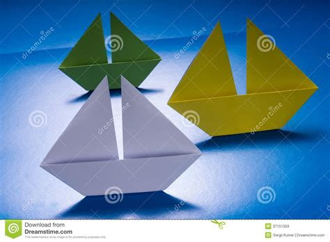 Origami Cruise Ship - paper boats sailing on blue paper sea origami ship