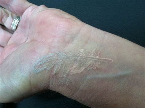 feather tattoo on wrist meaning cute white ink feather tattoo on wrist tattooimages biz