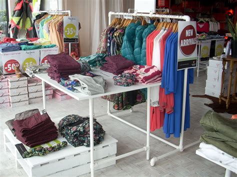 display tables for boutique retail clothing racks stylish easy to configure racks