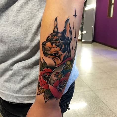 3d angry doberman with red flowers tattoo on forearm for men
