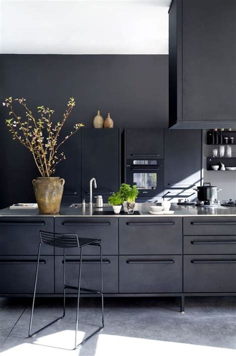 black kitchen picture of cozy industrial all black kitchen clad with metal