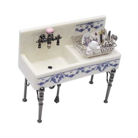 fancy kitchen sink with filled dish drainer by reutter