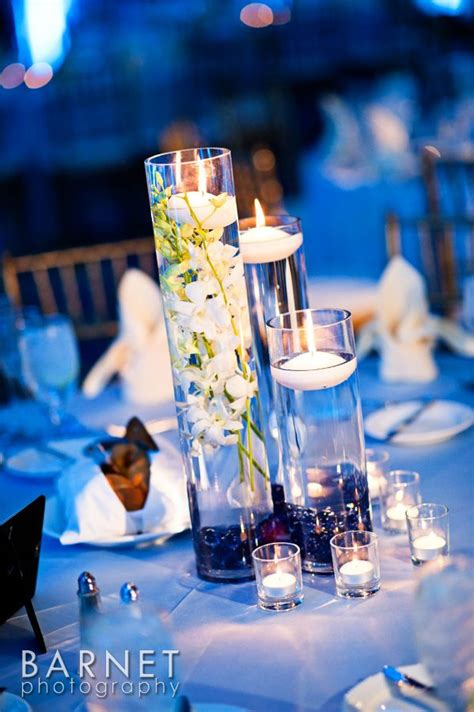Cylinder Vases With Floating Candles And Flowers by Cylinder Vases With Floating Candle Wedding Ideas