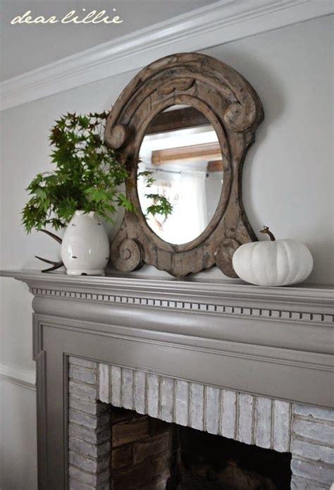 light gray walls white trim darker gray fireplace mantel