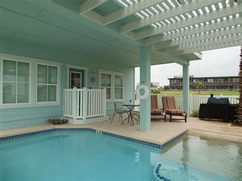 Port Aransas House Rentals by Small Pool And Grill In Backyard