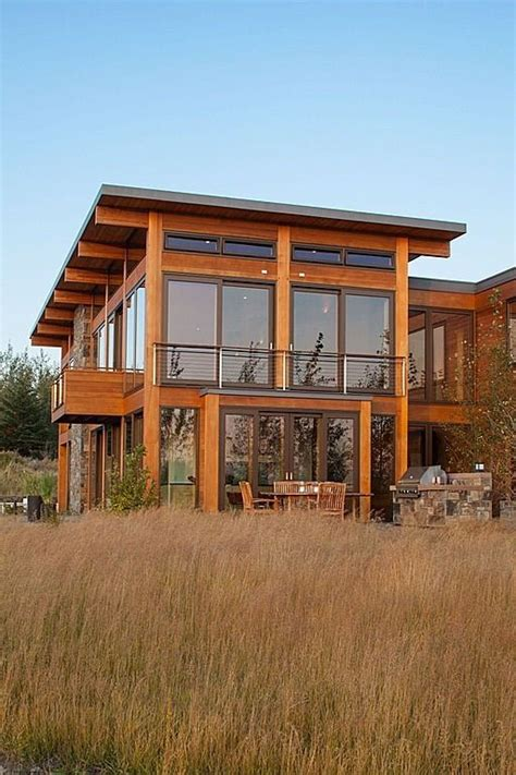 exterior large windows shed roof warm wood feels like a modern prairie style house also